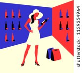 wine shopping. woman in a wine... | Shutterstock .eps vector #1129354964