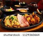 spicy chicken tonkatsu hot... | Shutterstock . vector #1129360664