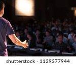 presenter speaking to audience... | Shutterstock . vector #1129377944