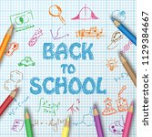back to school text drawing on...   Shutterstock .eps vector #1129384667