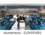 auto mechanic checking car... | Shutterstock . vector #1129391081
