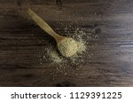 quinoa in a wooden ladle with... | Shutterstock . vector #1129391225