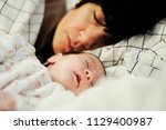 mother and cute little baby... | Shutterstock . vector #1129400987