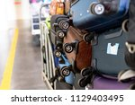 a lot of colorful suitcases ... | Shutterstock . vector #1129403495