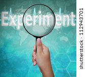 Experiment , word in Magnifying glass , background medical - stock photo