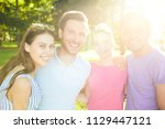 cheerful friends with toothy... | Shutterstock . vector #1129447121