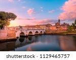 famous bridge in rimini  italy. ... | Shutterstock . vector #1129465757