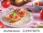 traditional italian bruschetta... | Shutterstock . vector #1129473074