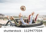 Stock photo happy people having fun in convertible car in summer vacation young tourist friends traveling in 1129477034