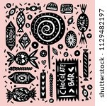 linocut style sweets and candy... | Shutterstock .eps vector #1129482197