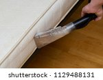 dry cleaning of an old white... | Shutterstock . vector #1129488131