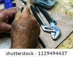 hands work  repair  job | Shutterstock . vector #1129494437