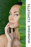 head and bare shoulders... | Shutterstock . vector #1129519751