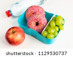 a plastic lunch box with donuts ... | Shutterstock . vector #1129530737