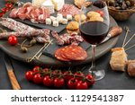 appetizers table with... | Shutterstock . vector #1129541387