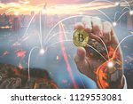 golden bitcoin in hand of... | Shutterstock . vector #1129553081