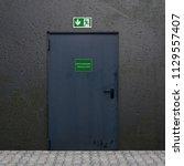 iron door with illuminated sign ... | Shutterstock . vector #1129557407