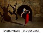 beautiful young woman doing... | Shutterstock . vector #1129559351