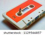 miniature man on a retro ... | Shutterstock . vector #1129566857