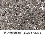 full frame take of a sheet of... | Shutterstock . vector #1129573331