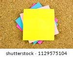 olorful paper blanks on cork...   Shutterstock . vector #1129575104