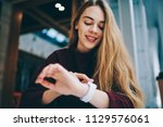 happy female teenager checking... | Shutterstock . vector #1129576061