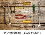 old technical tool top view on... | Shutterstock . vector #1129593347