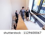 group of business people...   Shutterstock . vector #1129600067
