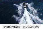 aerial bird's eye view of jet... | Shutterstock . vector #1129608599