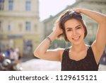 delightful brunette woman with... | Shutterstock . vector #1129615121