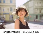 emotional brunette woman with... | Shutterstock . vector #1129615139