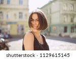 expressive brunette woman with... | Shutterstock . vector #1129615145