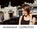 cheerful brunette woman with... | Shutterstock . vector #1129615151