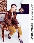 pretty stylish woman in fashion ... | Shutterstock . vector #1129617644