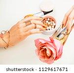 woman hands with golden... | Shutterstock . vector #1129617671