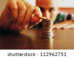 a man counts his coins on a... | Shutterstock . vector #112962751