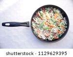mixture of frozen vegetables in ... | Shutterstock . vector #1129629395