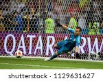 Small photo of Sochi, Russia - July 7, 2018. Russian national football team goalkeeper Igor Akinfeev denying penalty from Mateo Kovacic during penalty shootout in World Cup Quarter-final Russia vs Croatia.