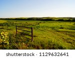 farm fence and meadow in the... | Shutterstock . vector #1129632641