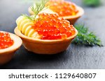 tartlets with red caviar close... | Shutterstock . vector #1129640807