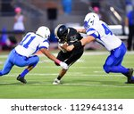 football player making a tackle ... | Shutterstock . vector #1129641314