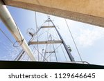 sailing yacht masts against sky ... | Shutterstock . vector #1129646645
