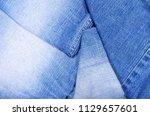 close up on folded denim ...   Shutterstock . vector #1129657601