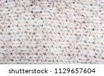 close up on knit woolen fabric...   Shutterstock . vector #1129657604