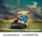 soccer player in dynamic action ... | Shutterstock . vector #1129660781