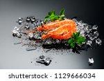 shrimps. fresh prawns on a... | Shutterstock . vector #1129666034
