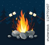 bonfire with marshmallow  stone ... | Shutterstock .eps vector #1129701437