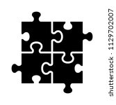 four pieces of jigsaw puzzle or ... | Shutterstock .eps vector #1129702007