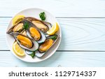 seafood mussels with lemon and... | Shutterstock . vector #1129714337