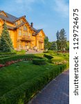 a huge wooden mansion with a...   Shutterstock . vector #1129724675